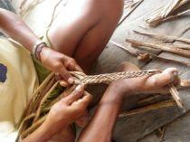 Venezuelan woman using feet to weave